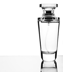 Perfume bottle on a glass surface