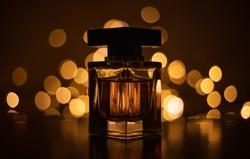 Perfume bottle on bokeh lights background
