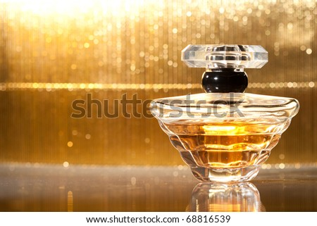 Perfume bottle on golden background
