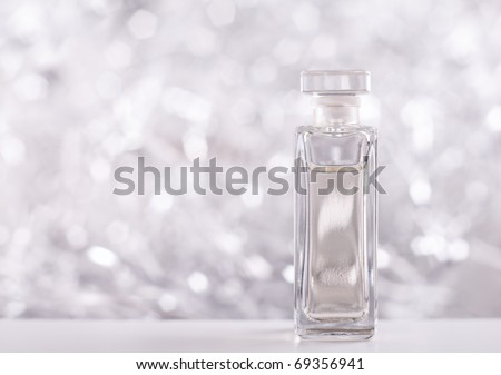 Perfume bottle on sparkling background