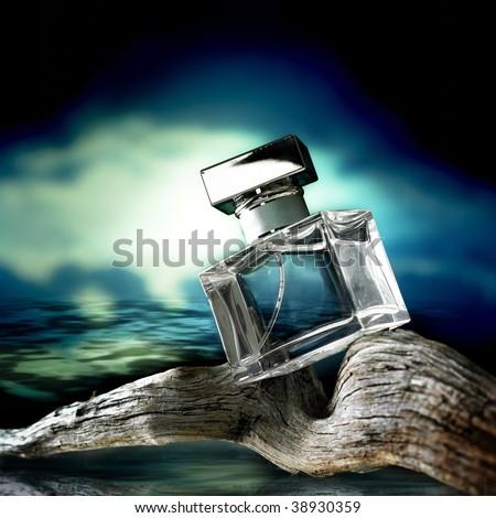 Perfume bottle on wood at sunset