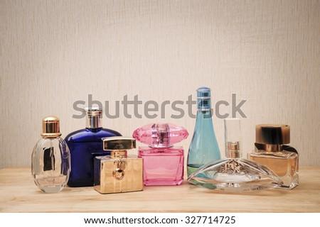 perfume bottle on wood desk on wall background