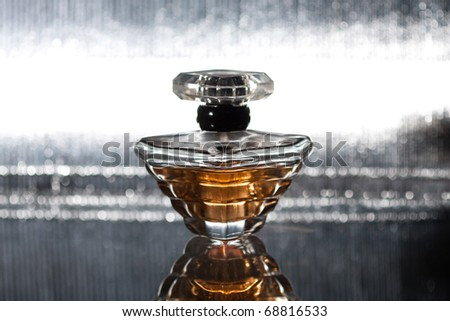 Perfume bottle with reflection on silver