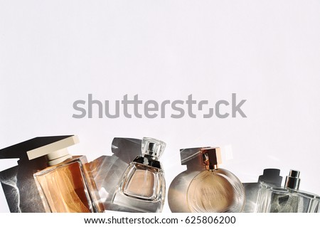 Perfume bottles in different sizes shapes on white background.