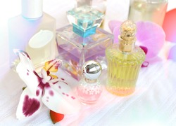 perfume bottles on the dressing table. different  bottles of perfume with orchid