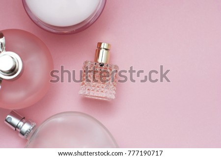 Perfume bottles pink background. Perfumery, cosmetics, fragrance collection. Flat lay with Copy Space. Women and Mother Day. #777190717