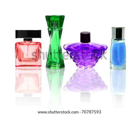 Perfume color glass bottles isolated on white with transparent reflection.