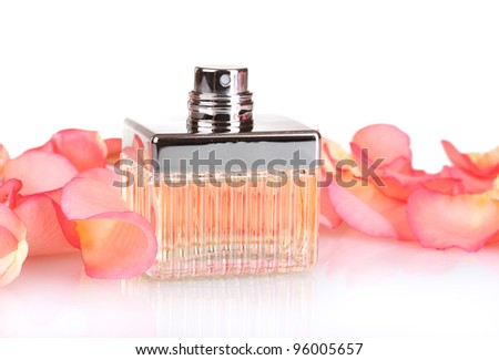 perfume in a beautiful bottle and petals  isolated on white - stock photo