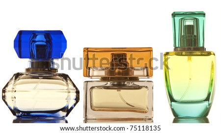 Perfume in a glass bottles on white background