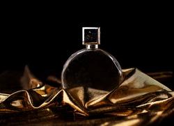 perfume in gold tones