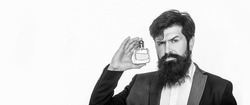 Perfume or cologne bottle and perfumery, scent cologne bottle, male holding cologne. Masculine perfume, bearded man in a suit. Male holding up bottle perfume. Man perfume, fragrance. Black and white.