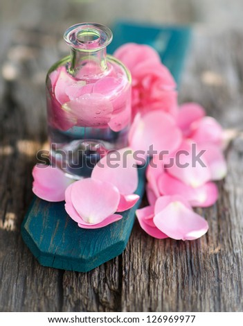 Perfume with rose leaves