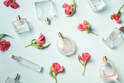 Perfumebottles and the wild orchids background