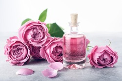 Perfumed Rose Water in glass bottle, roses.