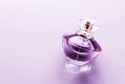 Perfumery, spa and branding concept - Purple perfume bottle on glossy background, sweet floral scent, glamour fragrance and eau de parfum as holiday gift and luxury beauty cosmetics brand design