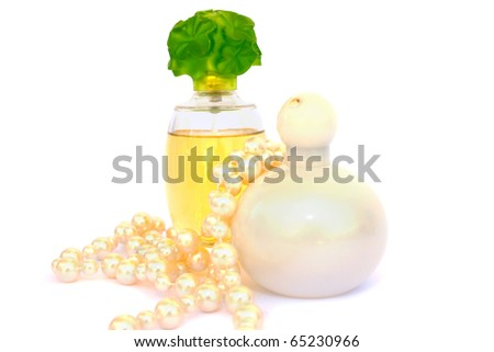 Perfumes and necklace isolated on white background.