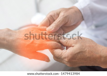 Peripheral Neuropathy concept. Doctor neurologist checkup old patient for symptoms of numbness, prickling or tingling in hands