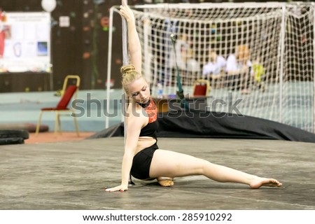 Perm, Russia - April 25, 2015. Championship Perm region at pole sport and dance. little girl blonde performs at competitions in pole dance