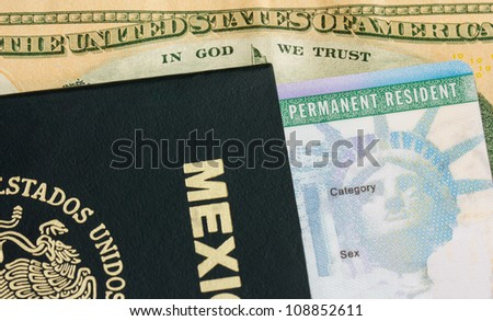 Permanent Resident - Green Card. A permanent resident card - Green card and a passport of Mexico. On the background a dollar bill from the United States of America