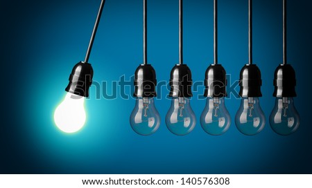 Perpetual motion with light bulbs. Idea concept on blue background.