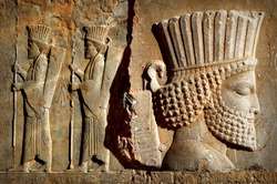 Persepolis is the capital of the ancient Achaemenid kingdom. sight of Iran. Ancient Persia. Bas-relief carved on the walls of old buildings. Composite image.