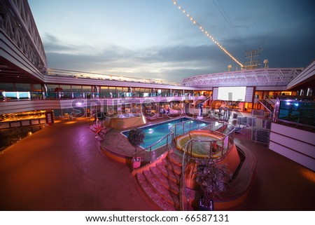 PERSIAN GULF - APRIL 14: Overview of the deck of Costa Deliziosa with screen, pool and baths - the newest Costa cruise ship, April 14, 2010 in Persian Gulf.