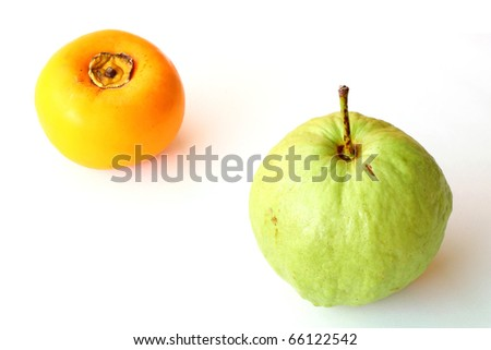 Persimmon and guava isolated on white