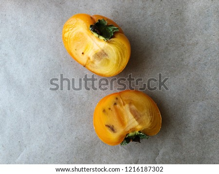 Persimmon fruit cut in half. Ripe. High resolution photography.