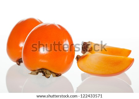 Persimmon fruits on white background