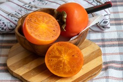Persimmon. It is an edible fruit that grows on a variety of trees in the genus Diospyros. Turkish name is Trabzon Persimmon