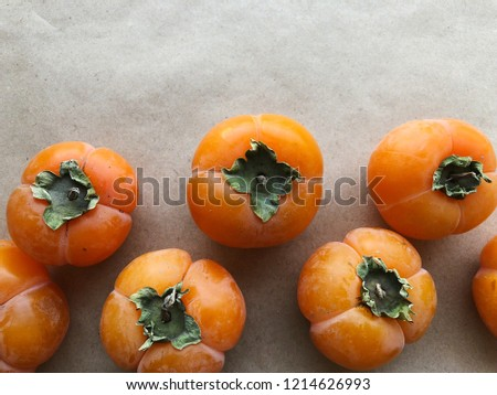 Persimmon pattern. Ripe fruit. Top view. High resolution photography.