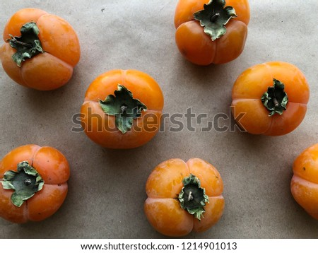 Persimmon ripe fruit on the table. High resolution photography.