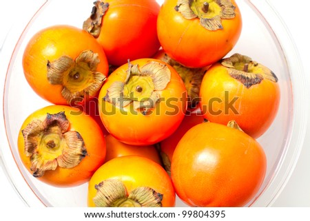 persimmons in a glass bowl