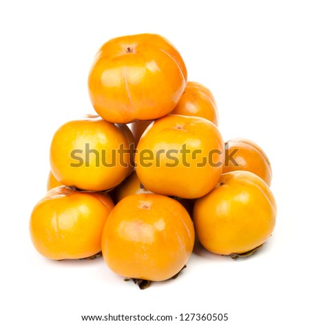Persimmons pyramid isolated on white background
