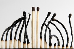persistent guys: 2 unharmed matches sticking out among a multitude of burned