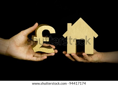 person buying a house with english pounds, black background