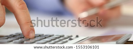 Person Calculate Profit Finance Budget Expenses. Hands of Financial Manager Taking Notes when Working, Calculating Balance. Internal Revenue Service Checking Document Using Calculator. Audit Concept