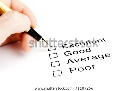 person checking excellent on a survey