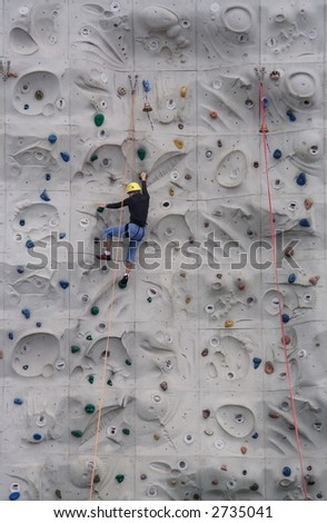 Person climbing on a wall