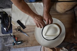 person doing the process of making the panama hat made in Ecuador