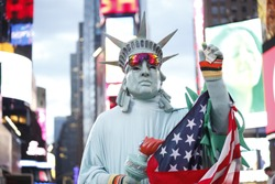 Person dressed as a costumed liberty statue at Times Square New York
