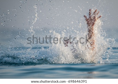 Person drowns in the sea Stock photo ©