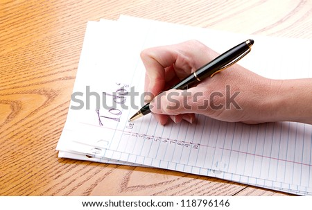 Person filling out a to do list