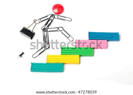 person from paper clips runs on a plasticine ladder - stock photo
