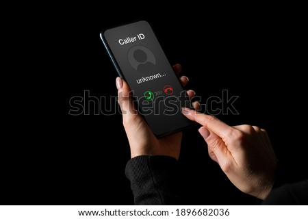 Person getting a call on phone from an unknown number Сток-фото ©