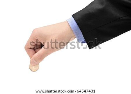 Person holding a coin isolated against white background