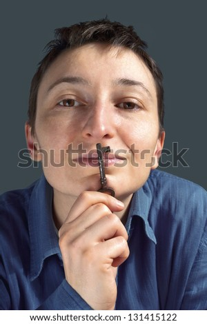 Person holding an old key on the lips