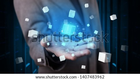 Person holding hologram projection displaying white cubes in server room