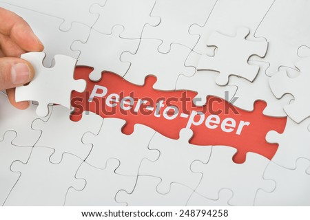 Person Holding Jigsaw Puzzle Piece With Peer-to-peer Text #248794258