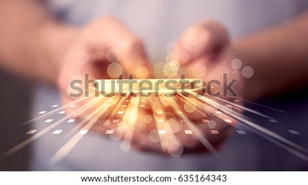 Person holding smarthphone with technology light applications comming out